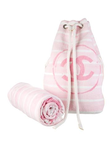 Pink and white Chanel beach set including terry towel and matching beach bag featuring CC logo throughout.