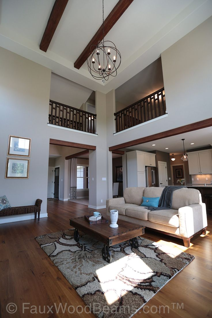 Open Plan Living Room With Faux Beachwood Beams And Wire Orbital Chandelier Master Bedroom