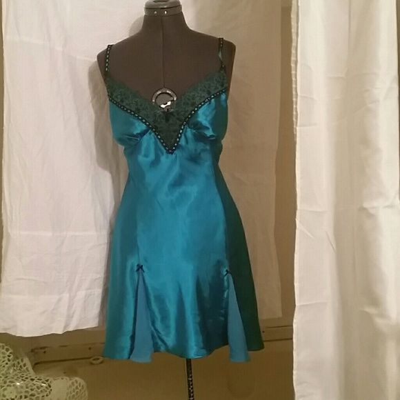 Price droppedBeautiful turquoise satin nightie This nightie is very elligent. Beautiful black lace trim .Cute bows and little sheer fabrics to add some flair .great condition. Worn once or twice. Bundle and save  new directions Intimates & Sleepwear Chemises & Slips