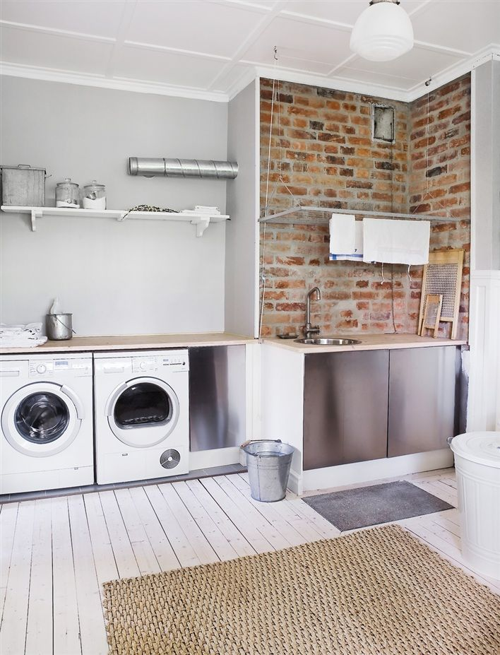 Laundry room and mudroom with brick facade