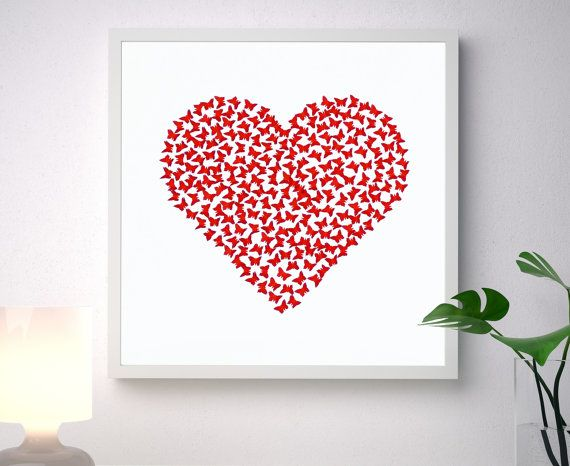 Unique handmade picture, made of more than 200 individually cut and placed 3D red art paper butterflies forming a classic heart shape, on a