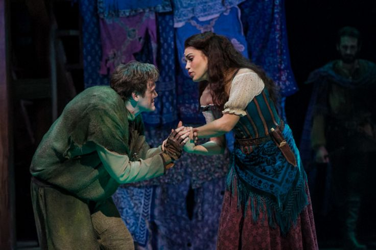 """hunchback and laura Laura iwaskiewicz, as esmeralda, and darik velez, as quasimodo, act out a scene during rehearsal of """"the hunchback of notre dame,"""" presented by the community."""