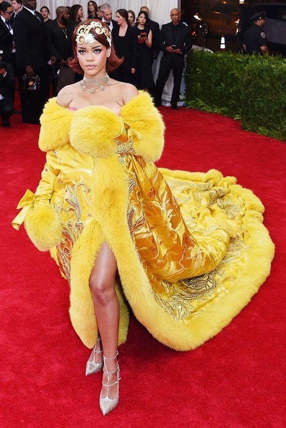 Met Gala 2015 - Rihanna. Hate fur.  Really hate this yellow fur sewn onto her grandmother's drapes. :) #rihanna #metgala