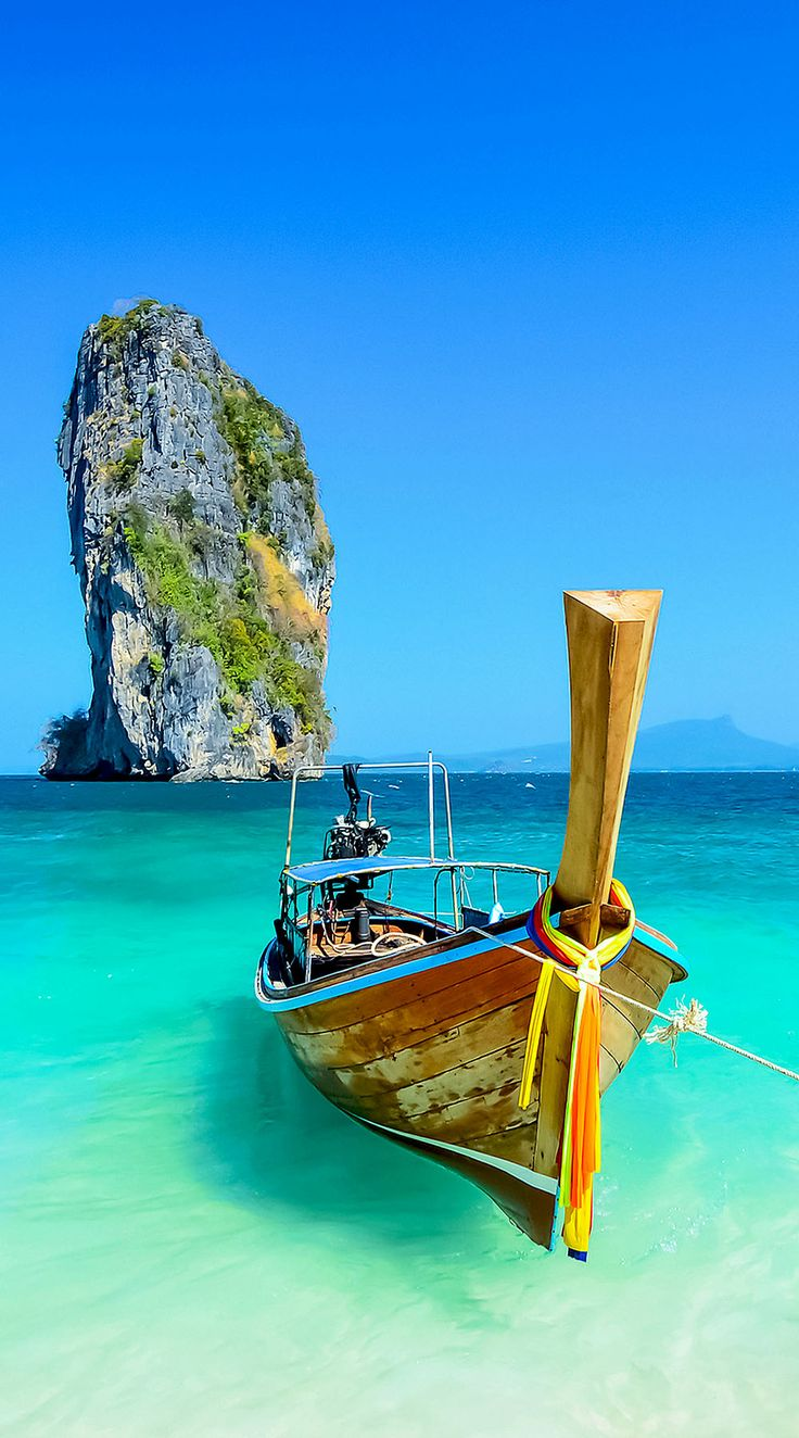 Cliff and boat in Krabi, Phuket, Thailand | 10 Idyllic Surreal Places that Make Thailand One of the Most Beautiful Country in The World.