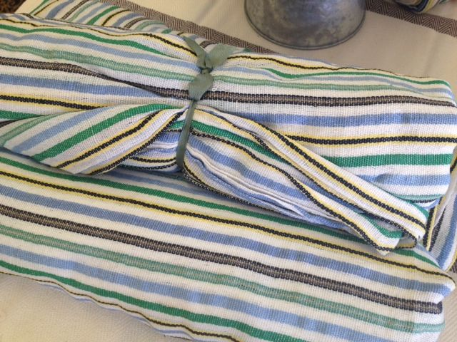 This lovely lightly woven beach blanket was hand made in Mexico using the softest traditional Mexican fabrics. It features a multi-colored striped pattern of different colors. There are three options available. And the size fits a full size bed.