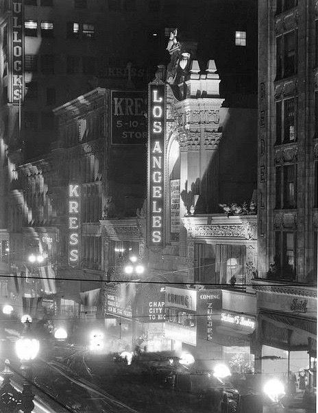"Here's a wonderful snapshot of life in Los Angeles in 1931, featuring three things that Angelenos at the time would all have known, but whose names are largely forgotten nowadays: the magnificently palatial Los Angeles Theatre (opened in 1931 with Chaplin's ""City Lights"" which is playing in this photo); Bullocks Department Store, which had a number of branches around LA, the best of which was on Wilshire; and Kress, a five-and-dime store whose best-known branch was on Hollywood Boulevard."