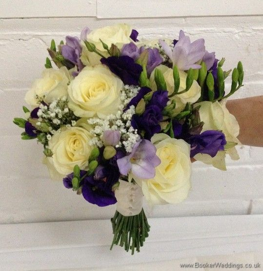 Purple and cream wedding flower Bridal Bouquet with ivory avalanche roses, purple lissianthus, lilac freesia and gypsophila Side View  Wedding Flowers Liverpool, Merseyside, Bridal Florist, Booker Flowers and Gifts, Booker Weddings
