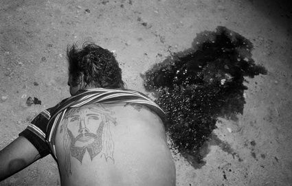 """Photographer Letizia Battaglia documented the height of violence in Palermo, Sicily during the Mafia wars from the 70s to the 90s. This image was taken in 1982 and titled """"The Two Christs"""""""