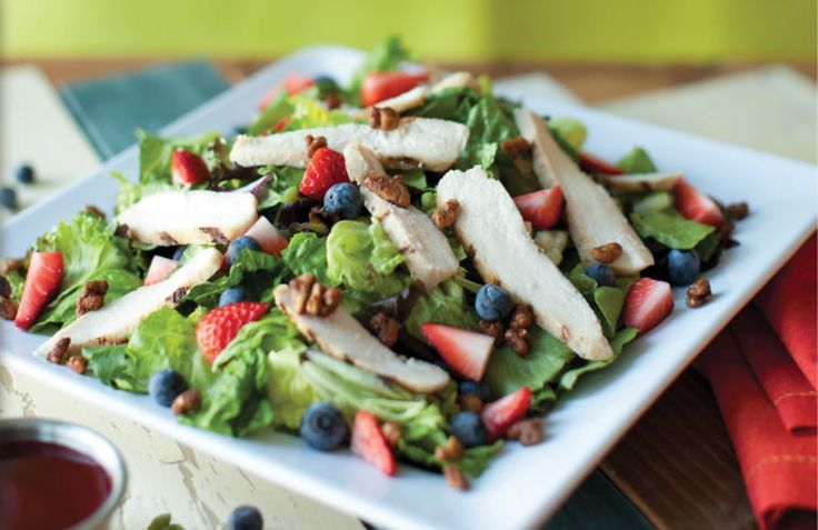 McAlister's Deli - Pecanberry Salad | features strawberries, blueberries, candied pecans,  grilled chicken on a bed of mixed greens with fat-free raspberry vinaigrette dressing.