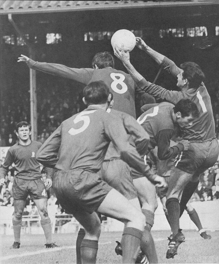 30th September 1967. Chelsea goalkeeper Peter Bonetti catches the ball under pressure team mate John Boyle (3) and Coventry City inside forward Ian Gibson (8), at Stamford Bridge.