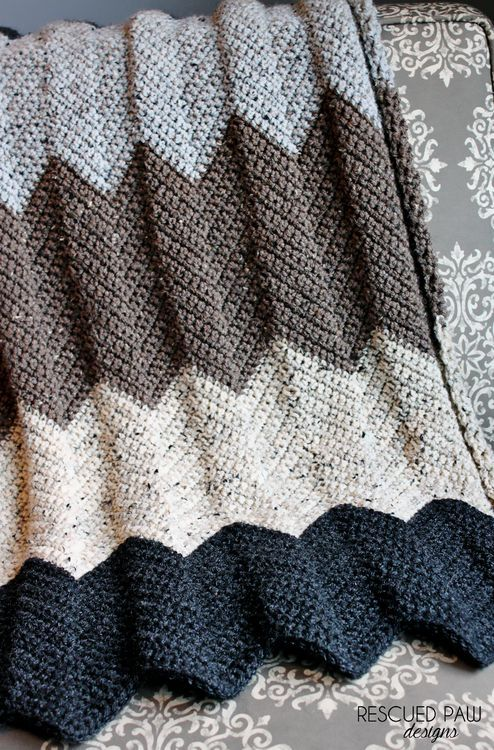This gorgeous chevrons afghan by Rescued Paw is the perfect accent for your home. Shown in beautiful neutral tones, but feel free to choose colors that match your own decor! Free pattern calls for 5 skeins of easy care Vanna's Choice and a size J crochet hook.