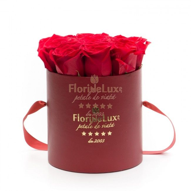 Red box with red roses - Unforgettable. Romantic. Amazing. Timeless. Offer her this special arrangement to tell her how much you love her. Order online from the best online flower shop in Romania, this elegant red box with satin handles filled with 9 red roses.