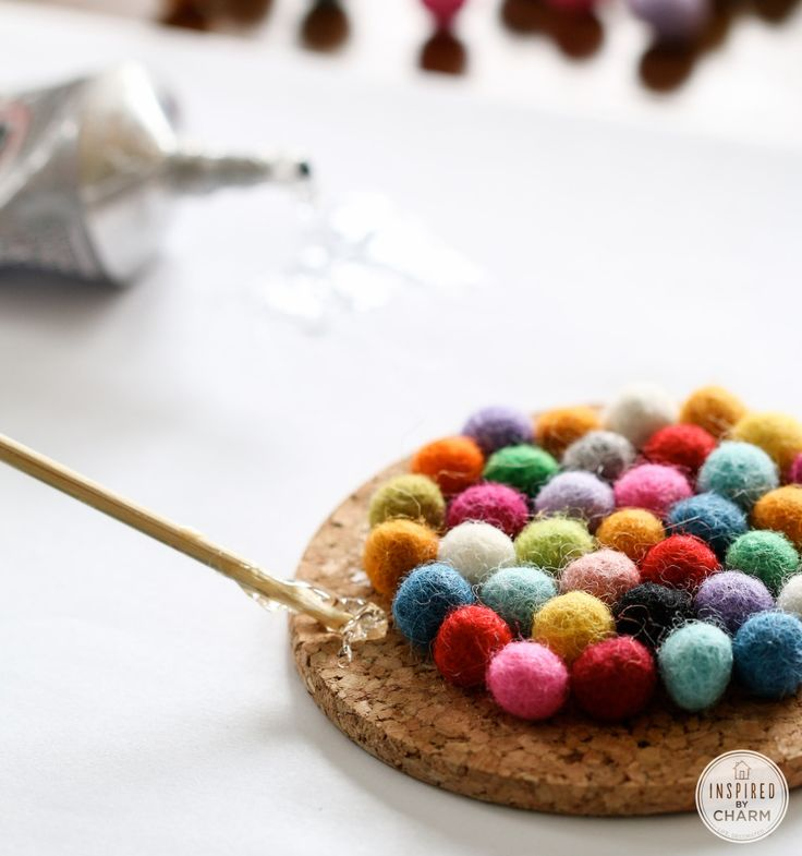 DIY felt ball coasters. Could do bigger felt balls and make a rug. Needs a backer but could totally work!