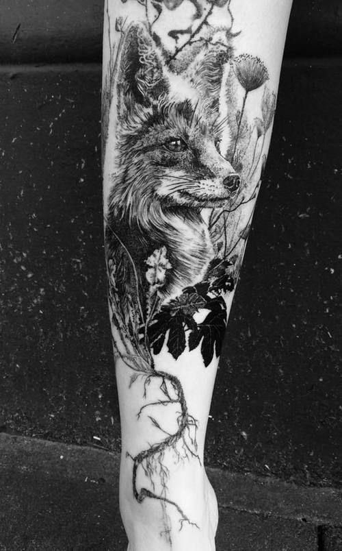 Realistic fox tattoo with plants in dotwork style