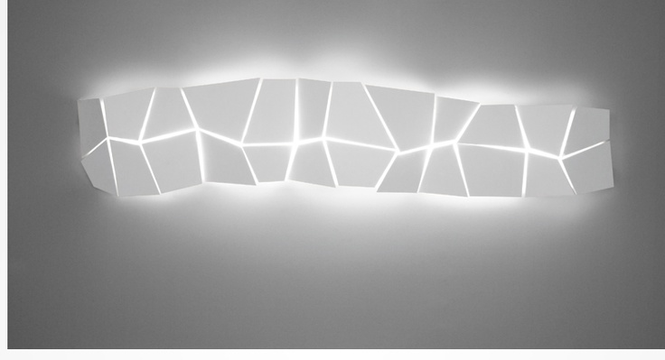 origami lamp  _ORIGAMI Twenty-four laser cut steel plates are held together with clear Mylar, creating an intimate lighting effect through narrow chinks between the plates. The angular profile of the Origami lamp washes the wall with an irregular luminosity.    painted mild steel 1700mm(L) X 300mm(H)