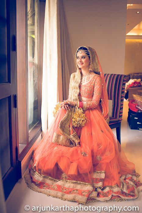 Orange and gold bridal lehenga. Indian bride. Beautiful
