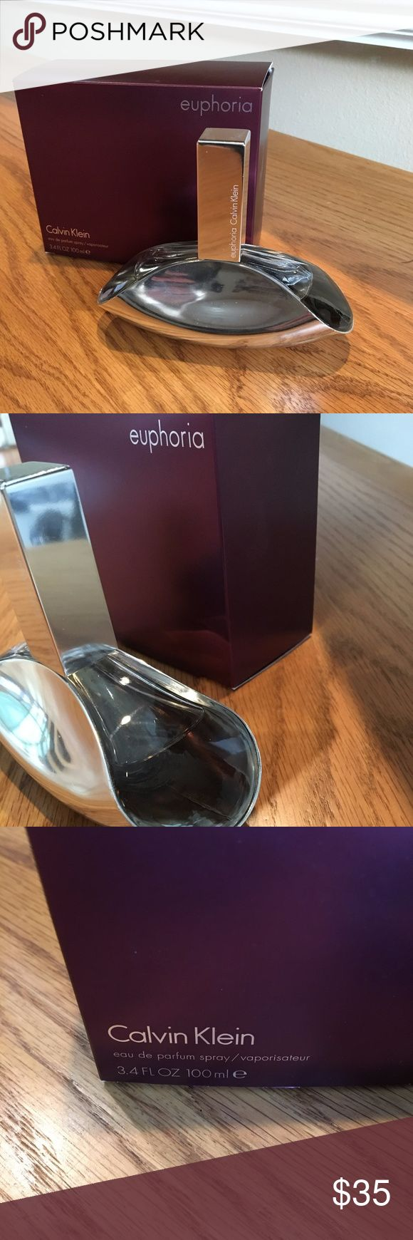 Euphoria By Calvin Klein Perfume Description: A captivating fragrance that contrasts between exotic fruits and seductive florals for a rich creamy seductive scent  Size: 3.4 oz. 100 ml Fragrance Type: Eau de Perfume Spray Packaging: Comes in Original Retail Box This Item Has Been Partially Used as Shown in the Pictures  Item Will Come Exactly as Pictured  Feel Free to Ask Questions & Make Offers!!! Calvin Klein Other