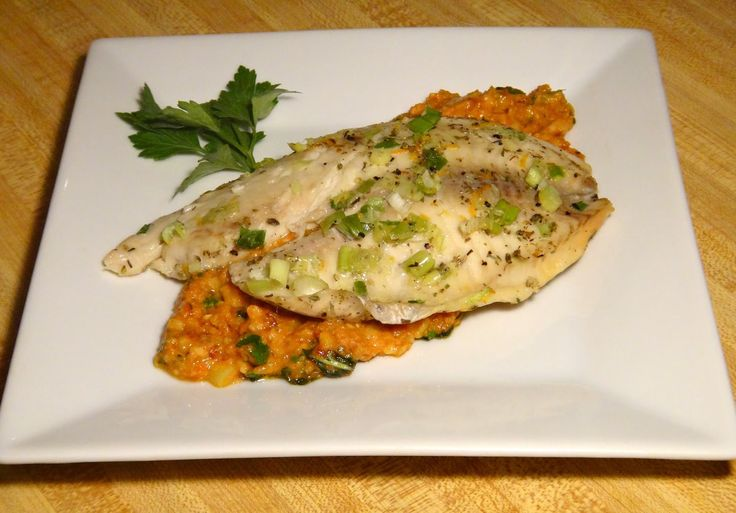 Baked Tilapia with Sun Dried Tomato Pesto *tilapia *sun dried tomato sauce *bake in oven *asiago cheese