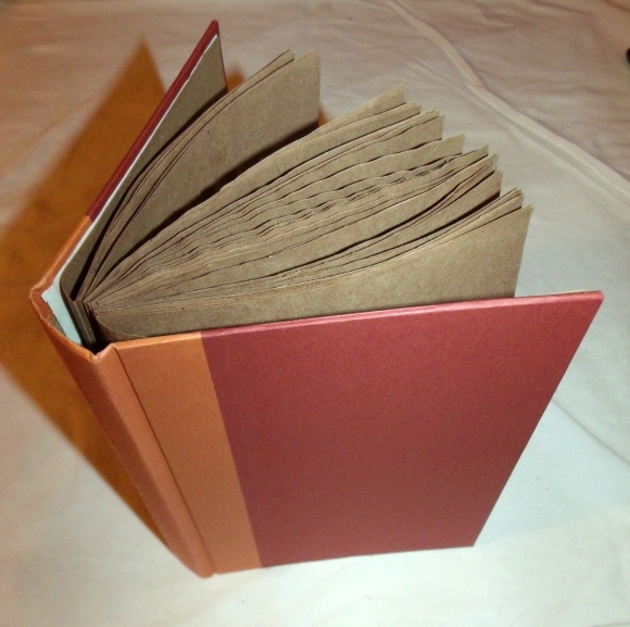paper bags and a hard cover book super cute!
