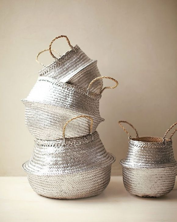 Silver spray painted baskets. I would love to do this to my wicker trunk and leave all the hardware brass!