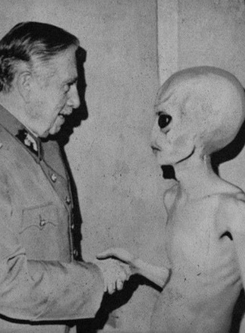 Alien shaking hands with I'm not sure who or about what..We're Not Alone people..