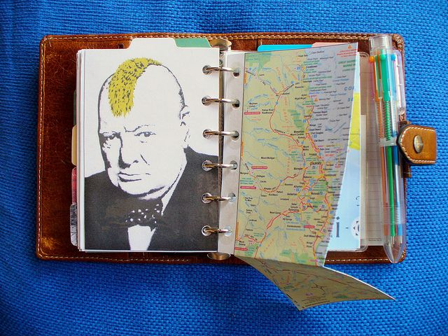 'Travel' tab (side2)    Banksy-ish Winston Churchill postcard.    Travel section includes:    *Tropical North Queensland Map  *Bali, Indonesia Map  *London Street Map  *UK Map  *World Map  *France Map  *French Language Guide  *International tried & recommended accomodation, travel websites etc.