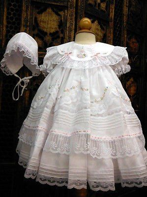 So many beautiful details in this darling dress! Classic heirloom dress with white sheer overlay has layers of lace and ruffles for beautiful fullness. Satin pi