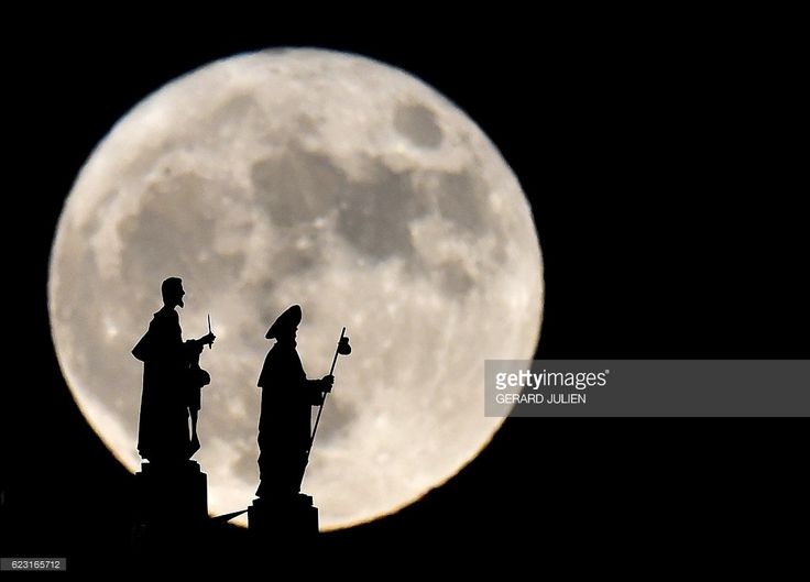 Statues on the Almudena cathedral are silhouetted against a Supermoon in Madrid on November 14, 2016. The phenomenon happens when the moon is full at the same time as, or very near, perigee -- its closest point to Earth on an elliptical, monthly orbit. It was the closest to Earth since 1948 at a distance of 356,509 kilometres (221,524 miles), creating what NASA described as 'an extra-supermoon'. JULIEN