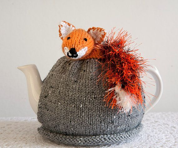 Foxy Tea Cosy - Handknitted tea cosy with a cute little fox character perched on top by CrystalMoonCat on Etsy, $29.00 #tea cosy  #foxes #tea cosies