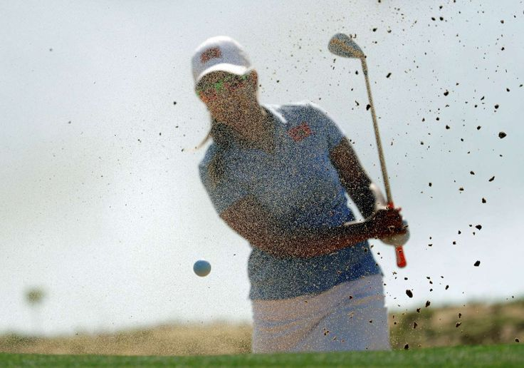 Sand blast:    Maha Haddioui of Morocco fails to chip safely on her first attempt from the bunker on the third hole during the first round of the golf event on Aug 17.