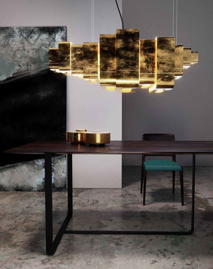 Beautiful contemporary dining room with dark grey walls, concrete floor and brass accents. The dark wood EM dining table has smooth, clean lines and artistic flair.