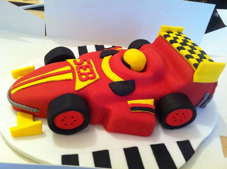 "Madeira and buttercream sponge FORMULA ONE RACING CAR CAKE. First ever attempt at a 3D effect cake. Designed from ""Karen Brown Easy Party Cakes"" book."