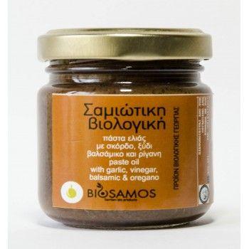 Η Biosamos παράγει και διαθέτει πιστοποιημένα προϊόντα βιολογικής καλλιέργειας, δικής μας παραγωγής, σε ιδιόκτητα αγροκτήματα. Ξεκίνησε το 1997 με αντικείμενο τη βιοδυναμική καλλιέργεια και την παραγωγή οπωροκηπευτικών και δέκα χρόνια μετά προχώρησε στη μεταποίηση. Τα προϊόντα BIOSAMOS πιστοποιούνται από τη ΔΗΩ. Βιολογική πάστα ελιάς Πάστα ελιάς με σκόρδο, ξύδι, βαλσάμικο και ρίγανη.