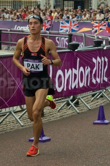 North Korean athlete PAK Song-Chol passes the 18 mile mark in the 2012 Olympic Marathon. He finished in 52nd place in 2:20.20.