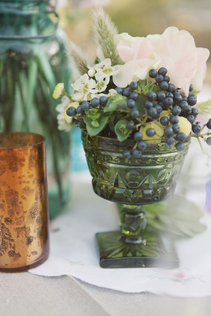 Vintage glasses used as vases for centerpieces decor