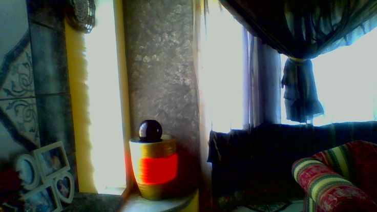 The garden Cement pot resembling a fountain at closer look next to the window.