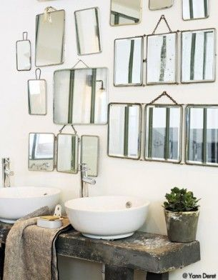 The sinks are beautiful and I love the rustic counter and mirrors. Great styling too :)