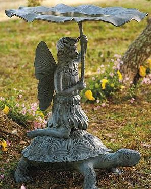 Astride a turtle, a winsome fairy graces your garden carrying a flower umbrella that doubles as a birdbath.Flower Umbrellas, Gardens Birdbaths, Fairyte Birdbaths, Fairies Gardens, Flower Gardens, Birds House, Fairytale Birdbaths, Gardens Carrie, Fairies Grace