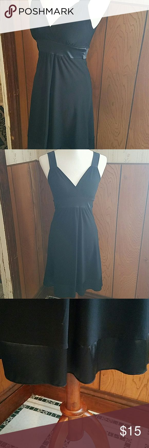 Little black dress Satan waist tie, goes around back. Wide Satan hem line and shoulder straps. Material has stretch to it. Taboo Dresses