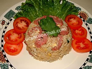 Put on a plate, top with cilantro leaves, and serve with slice tomatoes and green lettuce leaves