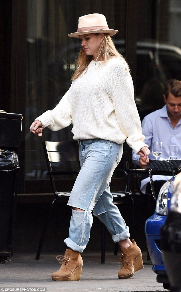 Stylish: Alice put on a dressed down display in rolled up jeans and an oversized jumper...