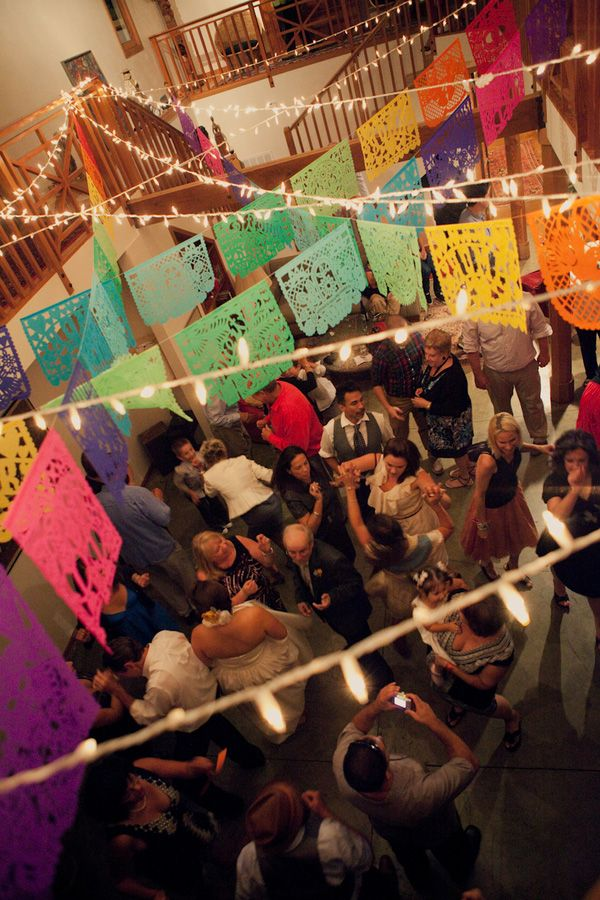Mexican papel picado banners are a lovely way to add a festive element to your event's ceiling. Source