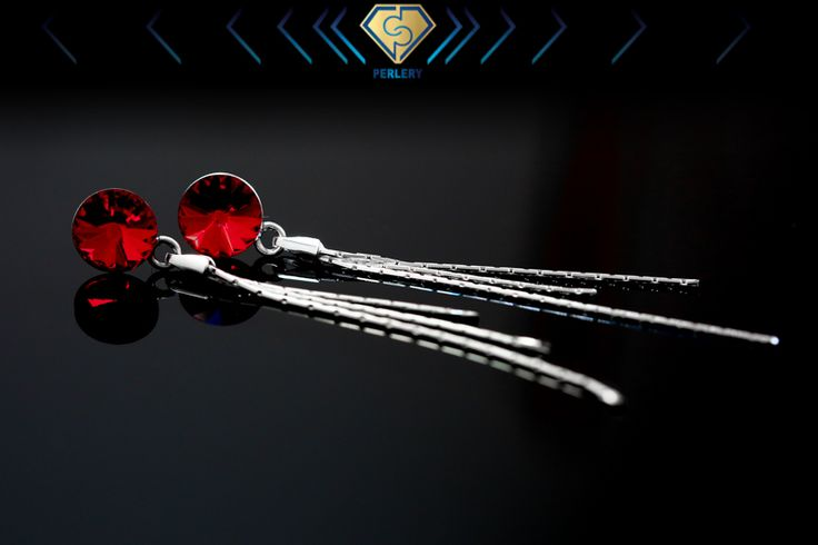 Swarovski silver earrings. Siam red color.