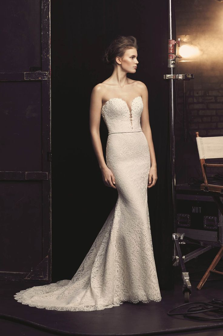 View our Plunging Neckline Wedding Dress - Style #2077 from Mikaella Bridal. Strapless lace gown with plunging neckline, beading, and fit and flare skirt.