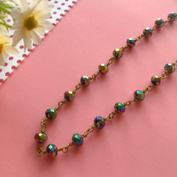 A new arrivals has been added to our collection! This iridescent chain choker sparkles and transitions in colour so beautifully!   Our grand opening sale is still running, please use the coupon code during checkout to receive 20% off your purchases :)