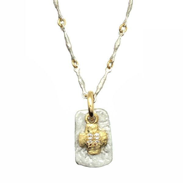 This layered two-tone necklace with one of our signature handcrafted chains is from our Old Money Collection. Embodying our desire for balance through form and texture. Old Money Cruz is a primitive e