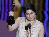 "Directors Sharmeen Obaid-Chinoy (L) and Daniel Junge, winners of the Best Documentary Short Subject for the film ""Saving Face"", pose with their Oscars during the 84th Academy Awards in Hollywood, California February 26, 2012"