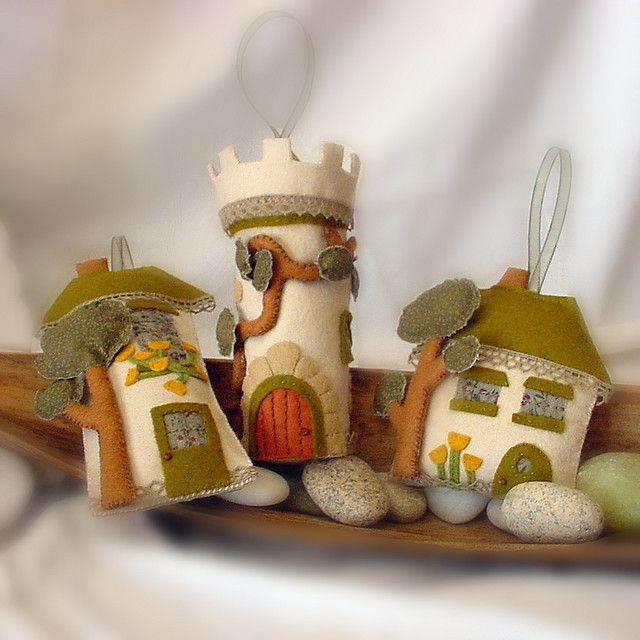 How about making one of these for each house we've lived in as Xmas ornaments? felt houses by maria at intres08