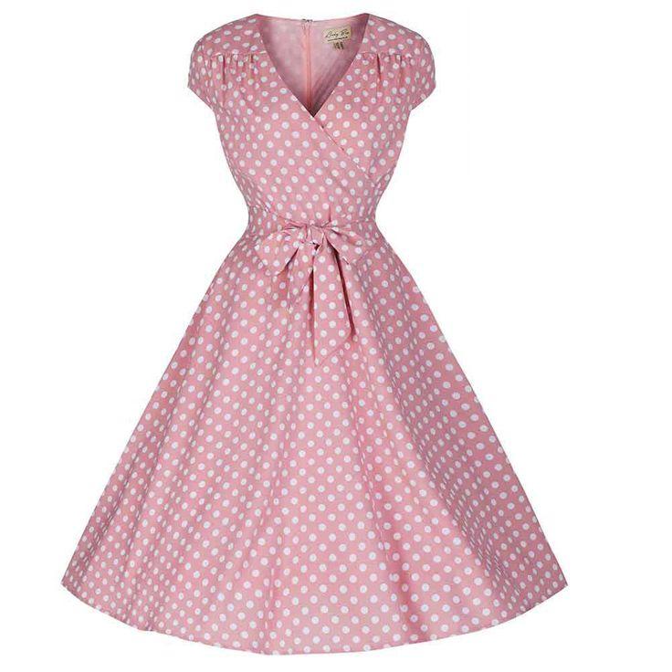 Lindy Bop. Deze eenvoudige en elegante jaren '40 stijl jurk in prachtige pastel pink met witte polkadots is een prachtige toevoeging aan je vintage garderobe. De jurk is gemaakt van goede kwaliteit synthetische stof en heeft een swing rok, korte kapmouwtjes, een afneembaar ceintuur, verborgen rits en is volledig gevoerd. Zie de kleinere afbeelding voor de maattabel.