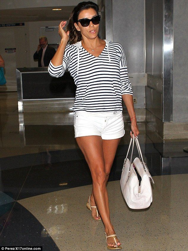 Short and sweet: Eva Longoria previously showed off her legs in hotpants at a Los Angeles airport on Thursday